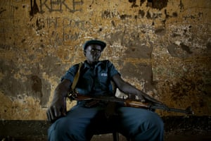 Sudan referendum: A southern Sudanese police officer on security detail at a polling station