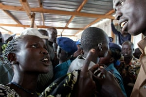 Sudan referendum: A southern Sudanese woman complains to a policeman about crowding