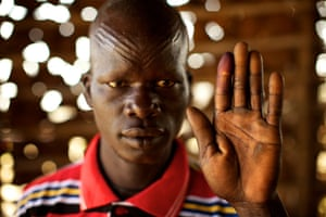 Sudan voters: Samuel Marsot holds up his ink-stained finger to show he voted