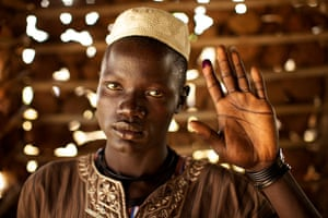 Sudan voters: James Kworis Juru holds up his ink-stained finger to show he voted