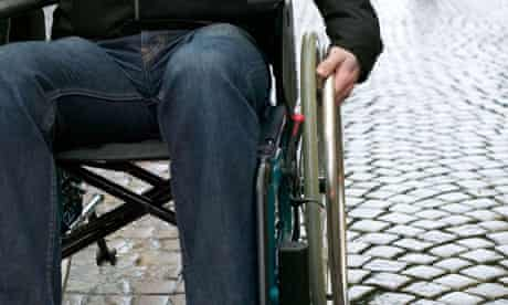 Disabled man in a wheelchair.