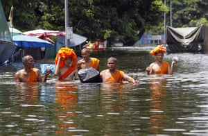Flooding in Thailand: Buddhist monks wade through a flooded site