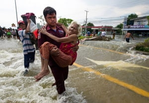 Flooding in Thailand: An elderly woman is evacuated