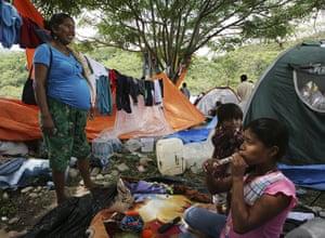 Bolivia Tipnis protests: B8 October: Bolivian indigenous people est near their tents at Caranavi