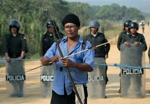 Bolivia Tipnis protests: 22 September: An indigenous man holds a bow and arrow in Yucomo
