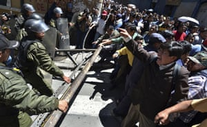 Bolivia Tipnis protests: 26 September: Protesters clash with police officers during a march