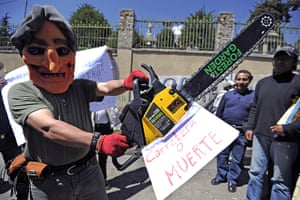 Bolivia Tipnis protests: 28 Septembee: A man wearing a mask depicting President Evo Morales