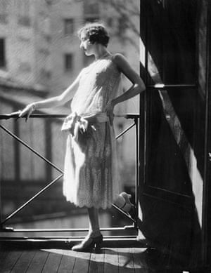 The history of lace: A woman modelling a typically twenties style grey silk and lace dress, 1924