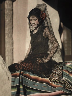 The history of lace: A young Mexican woman poses in a black mantilla costume, 1928