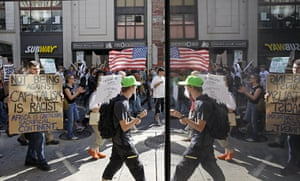 Occupy protests: Philadelphia: People hold signs and are reflected during their march