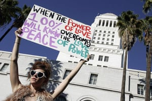 Occupy protests: Los Angeles: Jessica O'Donnell holds a sign at the Occupy LA protest