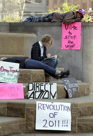 Occupy protests: Cleveland: Members of the group Occupy Cleveland rest on Public Square