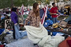 Occupy protests: New York: A woman folds blankets in the Occupy Wall Street protests