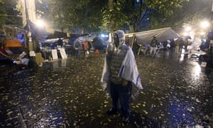 Occupy protests: Portland: A protester stands in the rain in Chapman Square