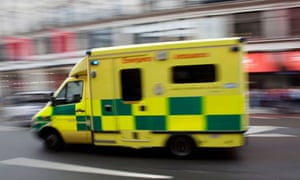 An ambulance passes at high speed in central London.