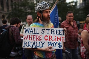 Occupy protests: New York: A Wall Street protester holds up a sign at Zuccotti Park