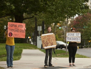 Occupy protests: Charlotte: Protesters with the occupy movement hold up signs