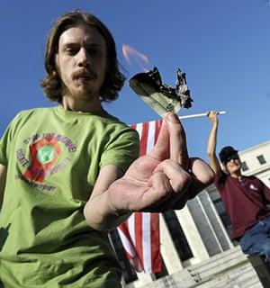 Occupy protests: Washington: A man burns a $1 bill