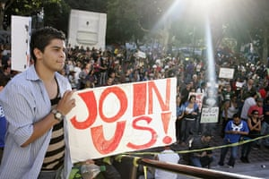 Occupy protests: Los Angeles: A demonstrator holds a sign at the Occupy LA protest
