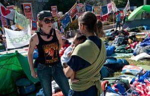 Occupy protests: Washington: Two women speak among tents and sleeping bags at Freedom Plaza
