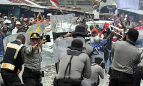 Indonesian Police clash with striking miners employed by US company Freeport McMoran
