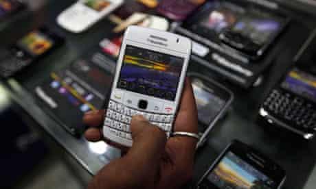 A customer holds a BlackBerry handset in Kolkata