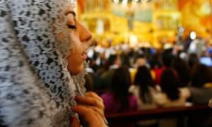Woman praying in an Amman church