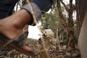 From the agencies: Manu Brabo: Libyan revolutionary fighters run for cover