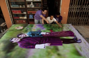 Bhutanese royal wedding: Shopkeepers prepare a large banner