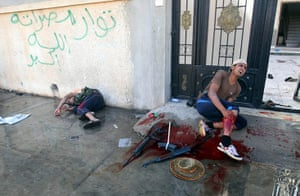 Sirte street battles: An injured rebel fighter screams for help after he was wounded