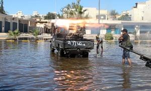 Sirte street battles: Libyan rebels fire rockets against pro-Gaddafi fighters