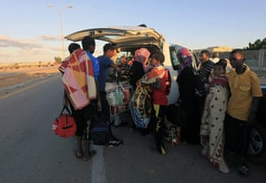 Sirte street battles: Families displaced from Sirte flee the fighting