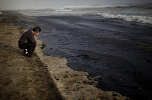 Rena oild spill: A man looks at waves coming in at Papamoa beach, Tauranga, New Zealand
