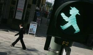Legal Battle Emerges Over Stoplight Pedestrian Figure
