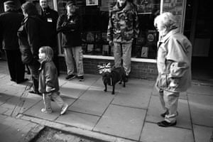 Wootton Bassett: A dog is seen wearing a union jack flag before the cortege