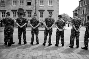 Wootton Bassett: Soldiers line the high street as they wait for a British serviceman