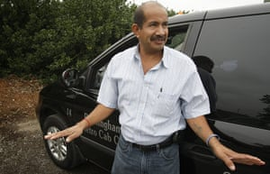 Alabama immigration: Cab driver Cineo Gonzalez takes a break at the airport in Birmingham