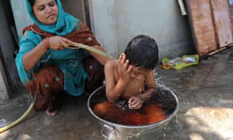 Rashidabanu Barkatali Qureshi bathes her