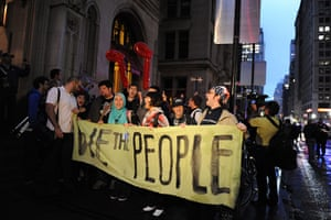Occupy Wall Street: Occupy Wall Street protesters march down Broadway