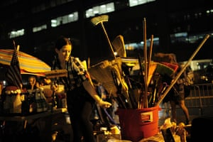 Occupy Wall Street: A member of Occupy Wall Street picks up a broom