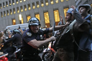 Occupy Wall Street: A New York City police officer shoves a demonstrator