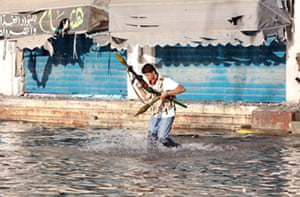 Libya, Sirte: A member of Libya's National Transitional Council fighting in Sirte
