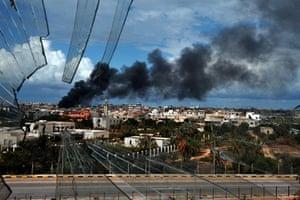 Libya, Sirte: Smoke rises from the centre Sirte