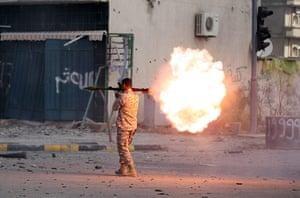 Libya, Sirte:  Libyan Rebel fighter fires an RPG, during the battle  in Sirte