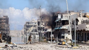 Libya, Sirte: A Libyan rebel fighter runs from incoming sniper's fire, Sirte