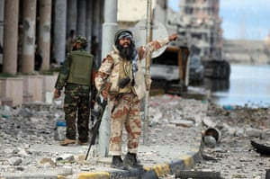 Libya, Sirte: A Libyan rebel gestures during the battle to liberate the city of Sirte