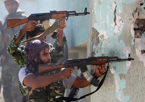 Libya, Sirte: Libyan National Transitional Council fighters fire at loyalist troops