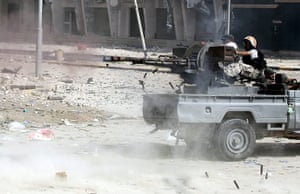 Libya, Sirte: Libyan rebel fighters fire at pro-Gaddafi forces during the battle