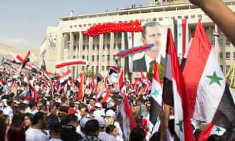 Assad supporters in Damascus on Wednesday