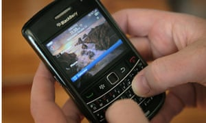 A BlackBerry owner in the US tries to use his phone